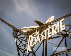 This original fine art photograph features The Roasteries trademark DC-3 airplane, one of the newest additions to the Kansas City skyline.