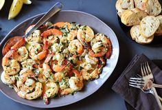 For this butter-and-garlic laden Italian-American scampi, buy the best shrimp you can find because the success of the dish depends on the quality of the seafood. I like to use a mix of herbs, and Pernod instead of white wine, for a unique flavor boost.