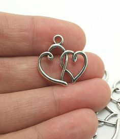 BULK 50 Heart Charms Silver Heart Charms by JewelArtology on Etsy