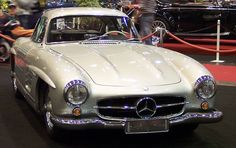 """This classic Mercedes-Benz 300 SL Gullwing Coupé is one of only 1400. The 300 SL was unveiled in February 1954 at the International Motor Sports Show in New York and was voted """"Sports car of the Century"""" in 1999. The distinctive gull wing version was only available from March 1955 to 1957. The car is best known for being the first to inject fuel directly into the cylinders, making it the world's fastest production car of its time."""