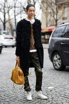 """Fei Fei Sun, model """"I'm wearing a Prada top, a Marni coat and Dries Van Noten trousers. My bag is Givenchy."""""""