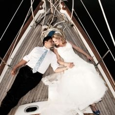 A nautical wedding on the beach with portraits on a sailboat!