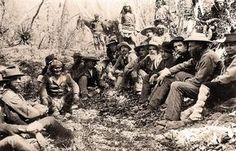 "The 1886 surrender negotiations were captured by C.S. Fly at Cañon de los Embudos in Sonora, Mexico. (From left) Capt. Cyrus Roberts, Geronimo, Concepcion, Nana, Noche, Lt. Marion Maus, Jose Maria, Antonio Besias, Jose Montoya, Capt. John G. Bourke, Gen. George Crook and Charles Roberts (the captain's 10-year-old son). ""The sun, the darkness, the winds are all listening to what we now say,"" Concepcion's translation of Geronimo's statement to Gen. Crook during the meeting.–"