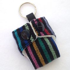 Cute Mini Cloth Nappy Keyring made with Hoppediz Timbuktu wrap scrap Great accessory for your changing bag Fleece lined and working snaps  If you have any questions, please feel free to send me a message!  You can also find me on Facebook https://www.facebook.com/pages/Girls-Got-Fabric