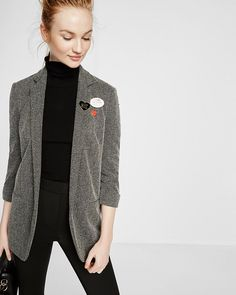 The narrow lapels of this jacket suggest formality, but its cuffed sleeve and herringbone pattern soften it. It's a work-appropriate style with the fashion-forward energy to follow a sparkly tank and skinnies into the night.