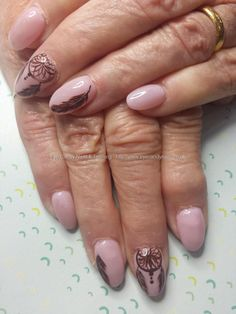 Pink gel polish with freehand feather and dreamcatcher nail art
