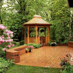 This gazebo is the architectural anchor of a large backyard entertainment area where guests can enjoy the shade and seclusion provided by the large trees. An adjoining brick patio is a great space for entertaining large groups. Dining tables can be set up, or the patio can serve as a dance floor.