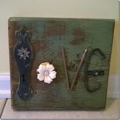 """""""Love"""" I pulled a bunch of lovely junk together to make this word:  a door plate, shower curtain hook flower, nails and a drawer pull.   I """"love"""" how it turned out!"""