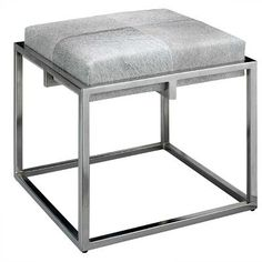 Jamie Young Company presents the chic, square Shelby Stool reflecting a metal frame, topped with a neutral grey cowhide cushion. From the living room to the bedroom, this extra seating adds a classic, authenic vibe to any decor style!