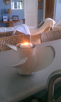 My use for a 75 Johnson boat propeller. Makes a perfect candle holder for the bar.