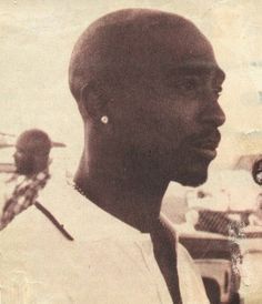 Tupac in deep thought thinkn of his next move