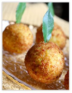 Arancine are one of the most traditional foods in all of Sicily .  These fried rice balls res...