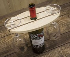 Wine bottle and glass display. Makes a great gift when paired with a fine bottle of wine.