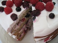 Berry Creme Frachie cake. The cake is a lemon poppy seed cake. The berries are raspberries, blueberries, and blackberries.