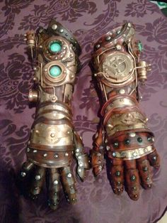 fully articulated steampunk gauntlets made from leather and brass