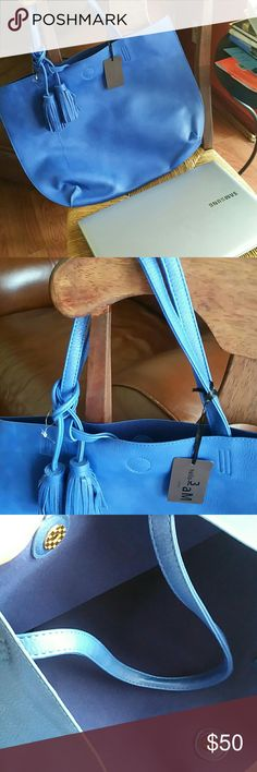 Large vegan  fringe tote Soft like a glove, beautiful pop of color for this season, 2016 fall is about mixing and matching different shades of blue, comes with small makeup bag,  and dust bag.  Large enough to fit a regular size laptop Bags Totes