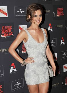 Cheryl Cole Loose Bun - Cheryl sported a loose bun with face framing bangs while hitting a party in Hollywood. | paired her drop dead stunning silver frock with a spiked bangle bracelet. | Hollywood Party AZ Label annual music party 4 June 2010