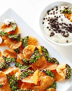 """This deconstructed version of cannoli transforms the filling of the traditional Sicilian pastry into a sweet, creamy dessert dip. Fried cannoli """"chips"""" stand in for the shell and are perfect for scooping."""