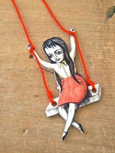 Girl on a swing shrink art drawing on red chord