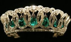 Grand Duchess Vladimir Tiara with Emeralds  The 1880s creation is made up of 15 intertwined diamond-set ovals. Pendant emeralds hang from the ovals, but they can be interchanged with pearls. Queen Elizabeth II now owns the tiara her grandmother purchased about 90 years ago