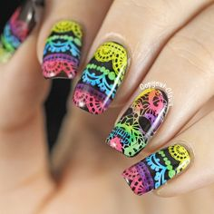 """Lacy Sugar Skull Nail Stamping. """"I used A England Camelot as the black base for these.  For the stamping I used Mundo de Unas White  and two images from MoYou London Gothic -05 [...] The reverse leadlighting was done using the 10.1 Polish Icing collection (the entire collection except for the orange, white and black)."""""""