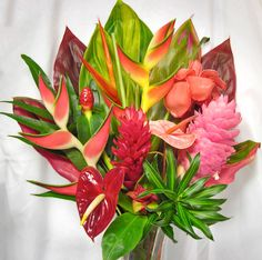 #14 Hamakua Bouquet $85 A gorgeous, beautifully arranged assortment of tropical flowers. We specialize in FRESH locally grown bouquets of anthuriums, foliage, protea, and mixed tropical flowers.   All bouquets are ready to assemble with vase or tray, and are shipped without additional charges. card and shipping included. Thank you for supporting persons with developmental disabilities in employment.