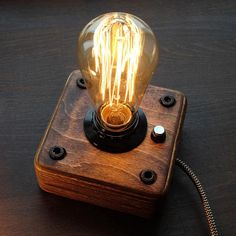 A wooden lamp, in the style of industrial, a steampunk for retro lamps EDISON. The lamp is made by hand from natural wood, polished and covered with Danish oil. DETAILS - Base Dimensions: 13cm*13cm*5,5cm(5*5*2,2inch) -Full height - 19,0cm (7,6 inch) - Cord Length: 160cm(64 inch)