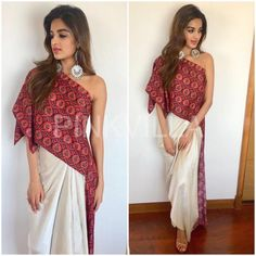 Nidhhi Agerwal served us another indo fusion look while promoting, 'Munna Michael'. She wore a draped one shoulder top that she paired with ivory h. Indian Fashion Dresses, Indian Gowns, Indian Designer Outfits, Indian Attire, Designer Dresses, Fashion Outfits, Indian Wedding Outfits, Indian Outfits, Wedding Dresses