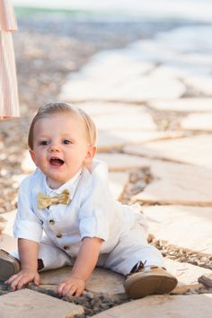 This little guy has stolen our hearts! http://www.stylemepretty.com/2014/10/29/elegant-and-cozy-backyard-wedding/ | Photography: Maria Del Rio - http://www.delriophotography.com/