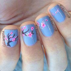 Blue Background + Cherry Blossom Nail Design