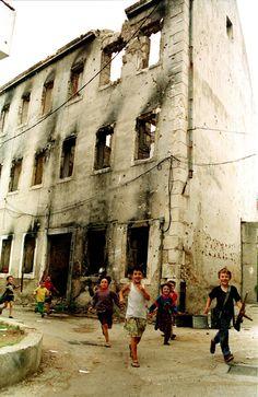 vukojebinaa: Children play war games in the war-torn town of Mostar, south Bosnia 1994 By Zoran Bozicevic