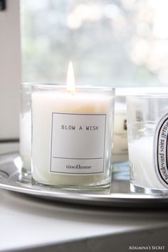Scented candles in white living room - Adalmina's Secret