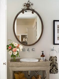 With limited wall space, small bathrooms require creative thinking when it comes to decorating. Transform a plain mirror into a standout feature with decorative trim! More small bathroom solutions here: http://www.bhg.com/bathroom/small/solutions/?socsrc=bhgpin032015framedmirror&page=1