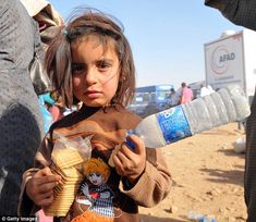 Innocence lost: A little girl clutches food.Some 138,000 Syrian Kurdish refugees have ent...