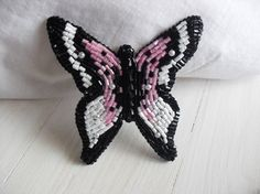 This butterfly brooch made of bugle, beads, seed beads. Back side of the brooch is from leather. I combined pink, white and black colors. Embroidery brooch is original gift for your kindred.  Size – 2,8*3 inches (7,5*7,7cm) Care: Do not wet the brooch, it can damage the product.  If you have any questions don't hesitate to contact me. Thanks for looking.  Back to my shop: https://www.etsy.com/shop/storesunshine