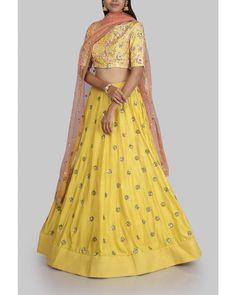 Stunning yellow color lehenga and blouse with orange net dupatta from Meenakshi collection of Mrunalini Rao. 29 September 2017
