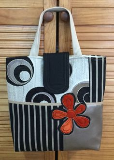 I made this tote from upholstery fabric - I added a vinyl patch, hessian trim and finished it off with an appliqued orange velvet flower! All recycled from fabric that was destined to the tip - feeling happy!