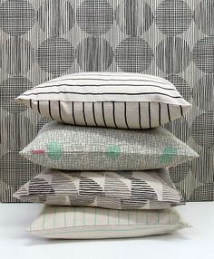 Skinny laMinx monochrome pillows with a pop of colour.