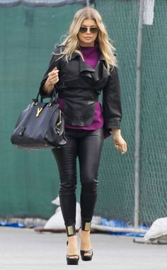 Fergie looks sleek in a leather jacket and leggings, while on her way to a photo shoot in Los Angeles.