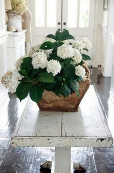 White flowers...we're struggling between casual farmhouse and a more sophisticated look.