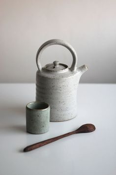 White crackle glazed teapot, waterpot and wooden spoon by /grainandknot/ .