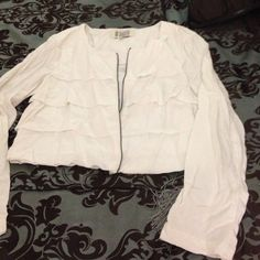 White zippered jacket Very lightweight white zippered jacket. Has ruffle design in front and back. Slight stain as seen in picture three but can probably come out in cleaners. BB Dakota Jackets & Coats