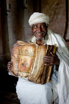 Ethiopian priest on Lake Tana with an 800-year-old goatskin bible, uncredited photo