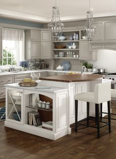 For an elegant look, add a crystal chandelier in the kitchen.