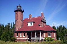 Squaw Island light house in Lake Michigan. Beaver Island, MI. Built in 1896. Still the original structure but light is not operativeable. Five to six miles north of Beaver Island. Can be reached by charter from Beaver Island.
