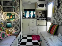 Love the use of wallpaper in a caravan, making it home from home. Nice combination of colours monochrome with bright pinks, blues, green.