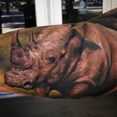 Crazy ink by Yomico Moreno. #Inked #inkedmag #tattoo #rhino #realism #animal #gorgeous #color