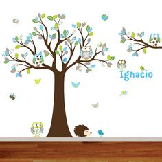 Decorating with trees brings whimsical art to your walls. This wall decal kit features a inspiring and engaging tree surrounded by colorful birds
