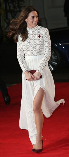 The wind played havoc with Catherine, Duchess of Cambridge's skirt causing her to flash more leg than she likely intended to during the premiere of the new film A Street Cat Called Bob