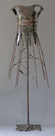 Donna McCollough. Metal sculpture of a dress